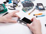 Repairman Disassembling Phone For Inspecting